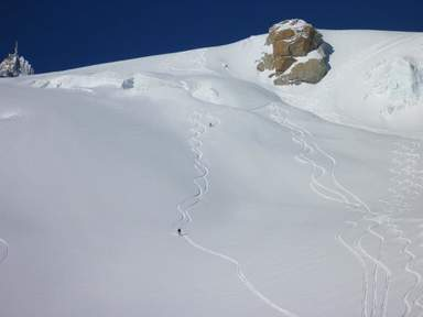 Leif_and_laura_skiing_getting_fresh_tracks_on_the_vallee_blanche_photo_-_yves